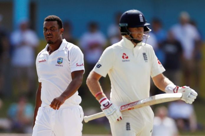 Shannon Gabriel looks to his left towards Joe Root, who turned to Gabriel.
