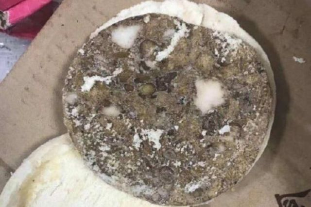 A photo showing mouldy bread allegedly found by parents at the Chengdu No 7 High School, in China. It is brown and on a box.