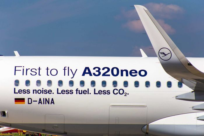 A close-up shows the rear quarter of an Airbus A320neo, with the words 'less noise. less fuel. less C02' printed on the side.
