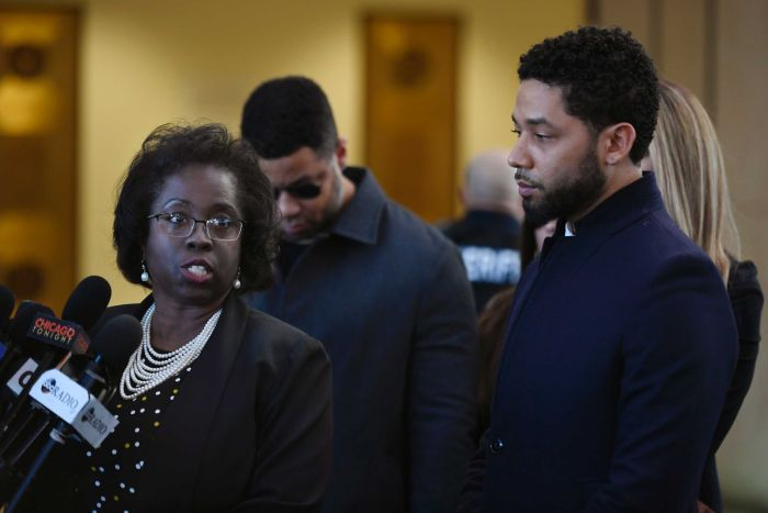 Actor Jussie Smollett, right, stands next to his attorney Patrica Brown Holmes during a news conference