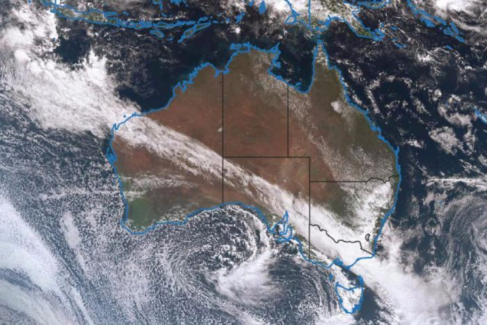 A satellite image of Australia showing a northwest cloud band moving south eastward over Australia.