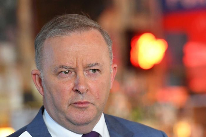 Anthony Albanese speaks to reporters in a pub.