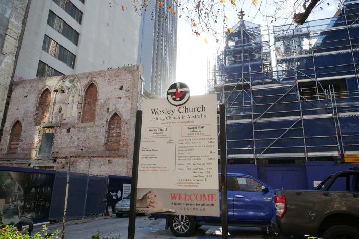 A large city construction site, with a Wesley Church sign out the front