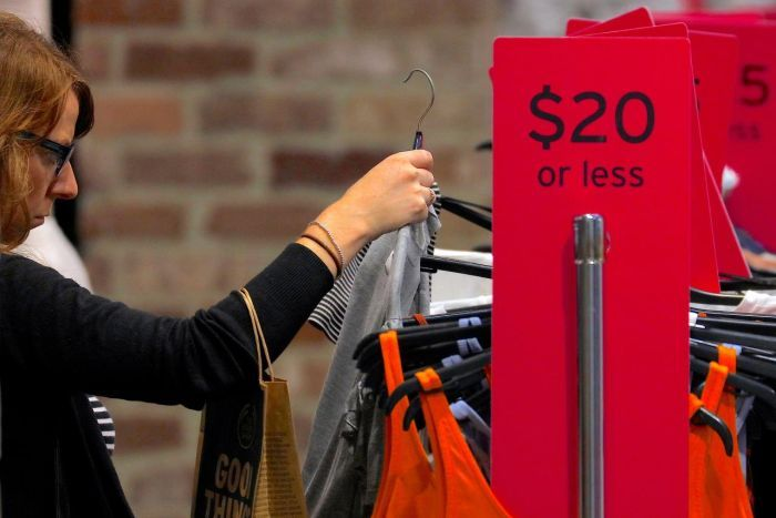 A shopper looks at clothes on sale at a retail store located in a shopping mall in central Sydney