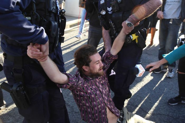 Police arrest protesters in Brisbane's CBD