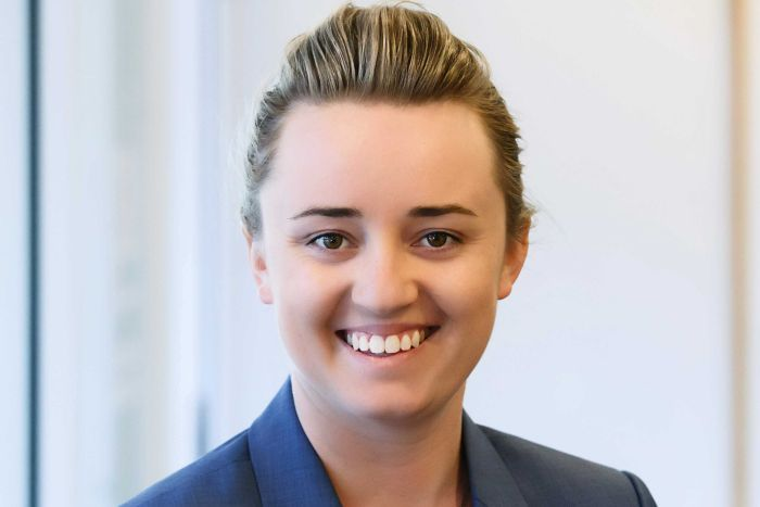 Young Canberra lawyer Caitlin Meers smiling