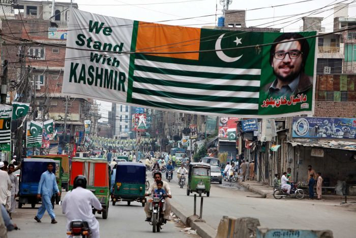 "The dense streets of Peshwar in Pakistan are festooned in banners and flags that say ""we stand with Kashmir"""