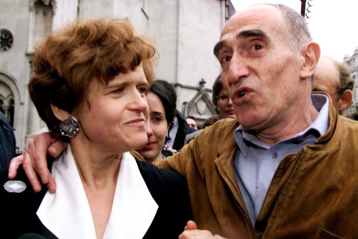 Deborah Lipstadt is congratulated by Holocaust survivor Martin Hecht as she leaves the High Court in central London.