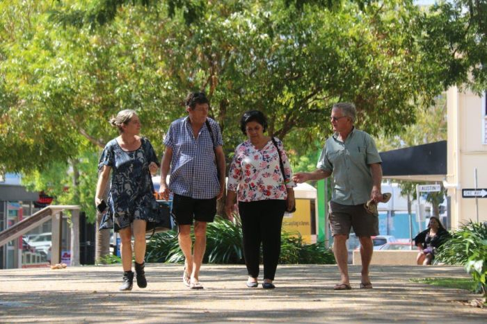 Former Timor-Leste pro-independence activists walk through Raintree Park in Darwin where they protested 20 years ago.