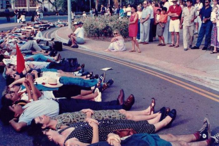 Darwin residents lie side-by-side in a city street in 1991 after news of the Santa Cruz massacre in Dili