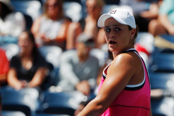 Ashleigh Barty looks back over her shoulder with a disappointed expression on her face