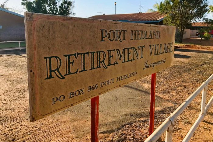 A sign out the front of a brick building that reads 'Port Hedland Retirement Village'