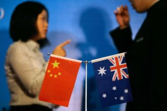 Chinese and Australian flags on the conference table