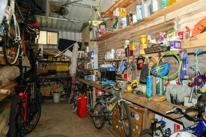 A garage full of clutter and various possessions.