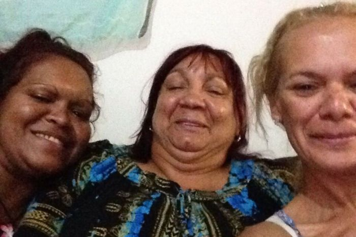 A selfie of three women with one pulling a thumbs up.