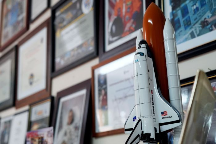 A model space shuttle, framed photos of astronauts, certificates and thank you letters mark the wall of Tony Hutchison's shack.