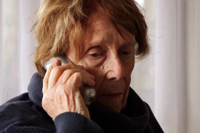Yvonne Pascoe holds a phone to her ear