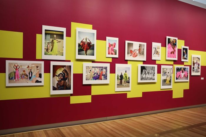 A brightly coloured wall of photographs shows pictures of Sudanese-born Australian, Adut Akech.