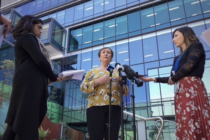Health executive Lesley Dwyer speaks to the media outside the Royal Adelaide Hospital.