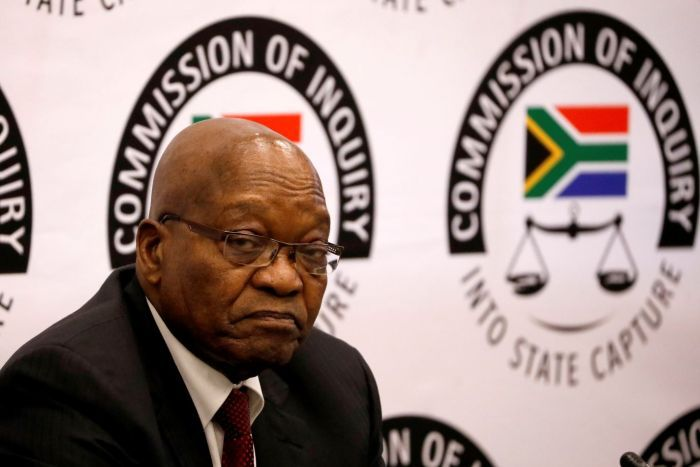 Jacob Zuma looks in the direction of the camera with an unhappy expression on his face.