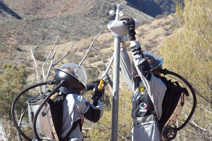 Simulation astronauts installing a weather station i
