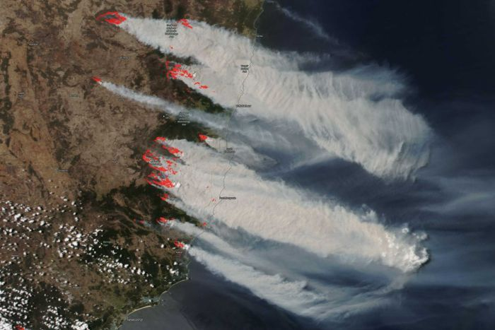 satellite image of the new south wales coastline with smoke billowing east