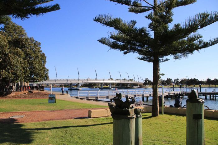 Mandurah foreshore looking toward a traffic bridge over the waterway.