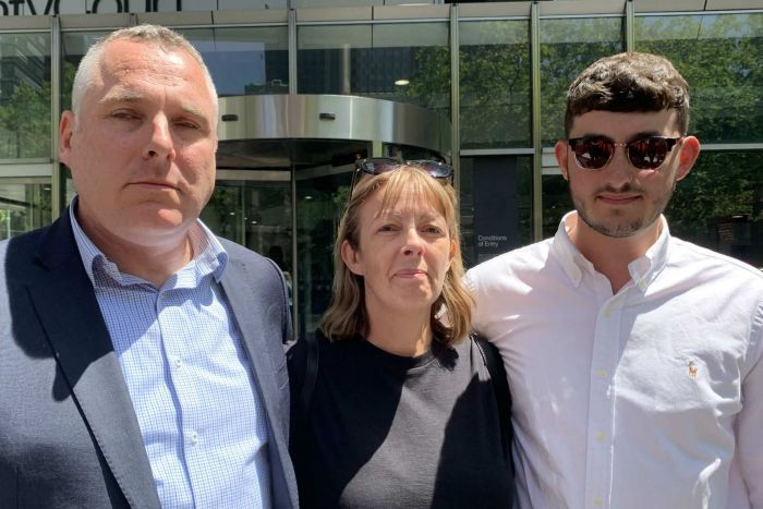 Stevan Waters, Paula Waters and Keiran Waters stand together outside the County Court in Melbourne.