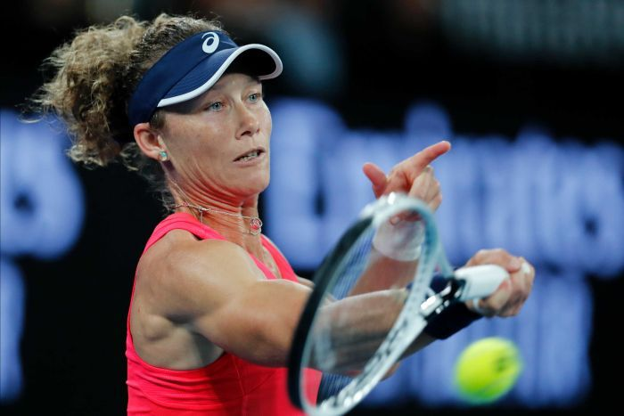 A tennis ball flies off Sam Stosur's racket as she hits a forehand.
