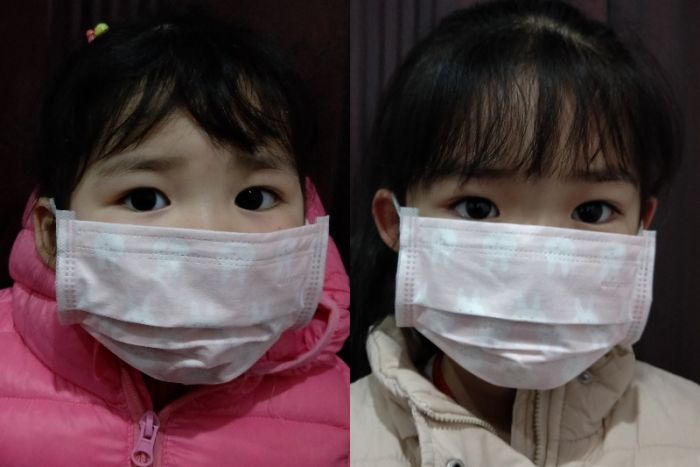 A composite image showing Hui Qiu's children, both are wearing surgical masks.