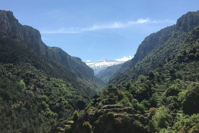 A dramatic view of mountains against a blue sky in Lebanon.