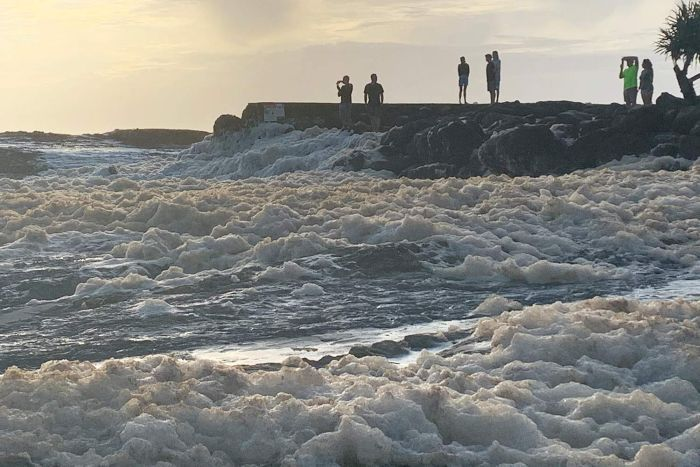 Frothy surf at Snapper Rocks after wild weather.