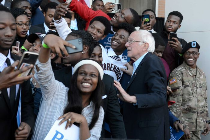 Bernie Sanders surrounded by young black supporters