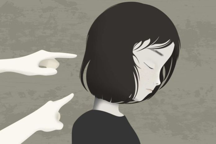 The still image shows an illustration of an Asian woman who looks sad when the fingers point at her.