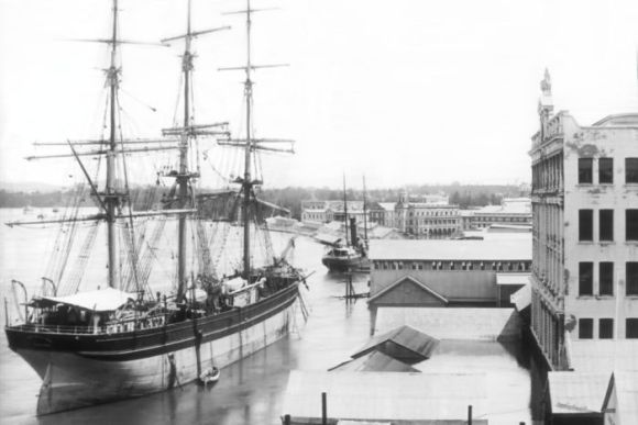 A ship docked at a wharf in Brisbane in the 1800s.