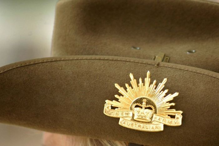 close up of a Rising Sun badge on the side of a slouch hat worn by a member of the Australian Army-1