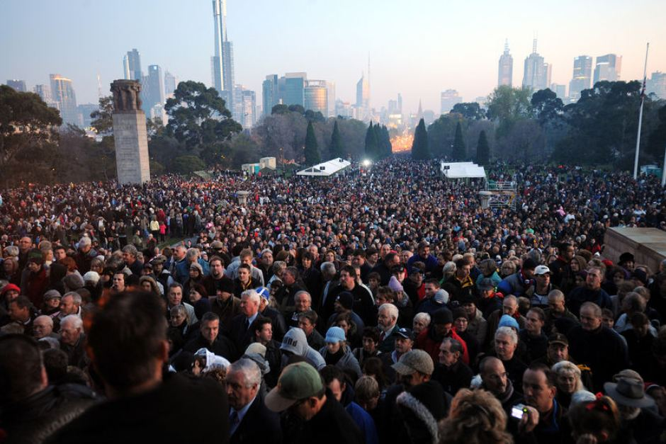 Large crowds gather on the footsteps of the Shrine of Remembrance for the dawn ANZAC service in Vic