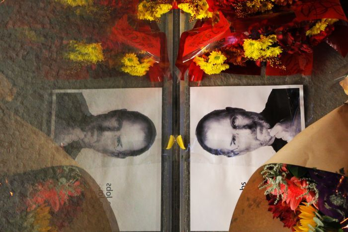 Flowers and a photograph of Steve Jobs