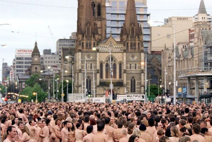A large crowd of naked people assembles in front of Melbourne's Federation Square.