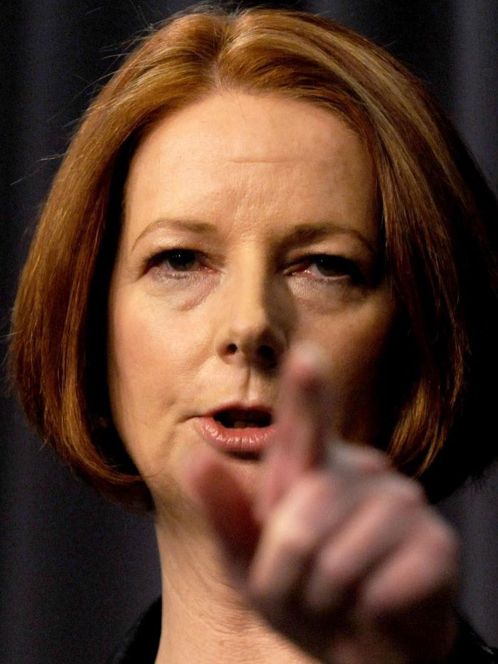 Julia Gillard points during a press conference in Canberra on October 13, 2011.