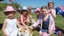 Girls petting corgis ahead of seeing the Queen