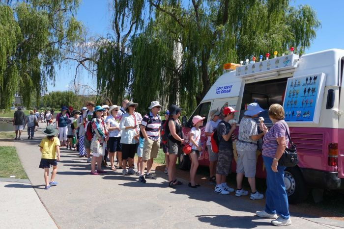Queue for the ice-cream truck on the shores of Lake Burley Griffin as part of Canberra's centenary celebrations.
