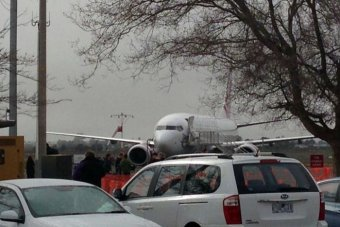 The plane, with 91 passengers on board, landed safely.