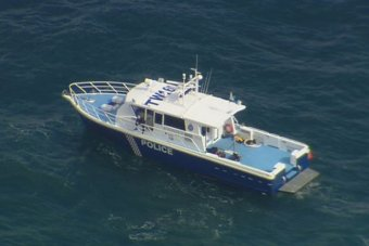 Aerial of WA police search boat looking for missing diver