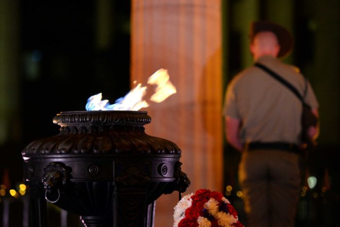 The eternal flame burns during the Anzac Day dawn service at the Cenotaph in Brisbane.