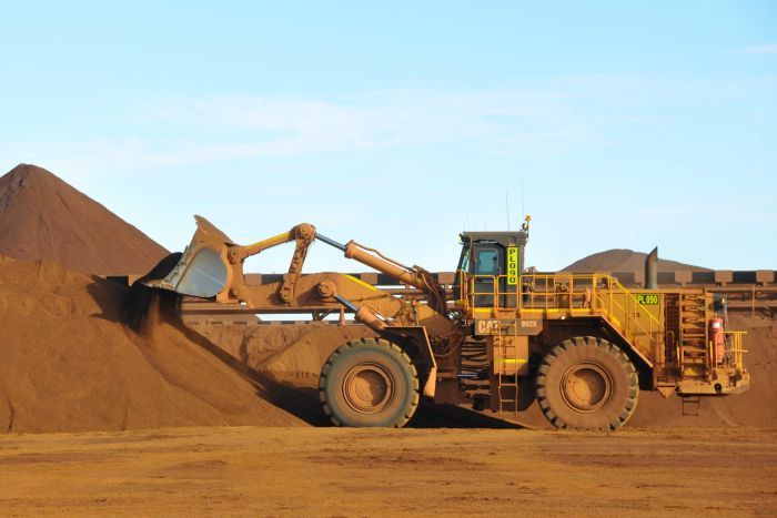 Worker mining for iron ore in the Pilbara.