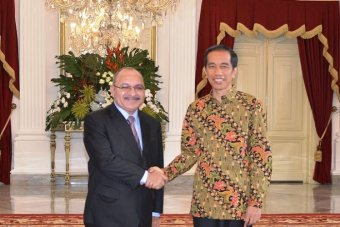 PM O'Neill is welcomed by the newly inaugurated President of Indonesia Joko Widodo at the Presidential Palace in Jakarta