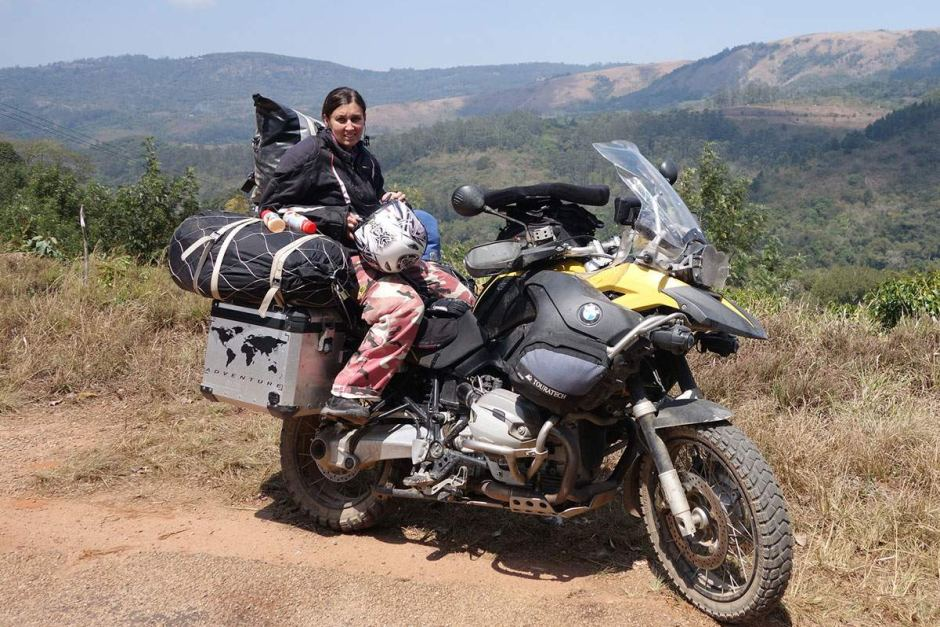 Tanya Griffioen on the back of the couple's BMW motorbike on which they had travelled extensively through Africa.