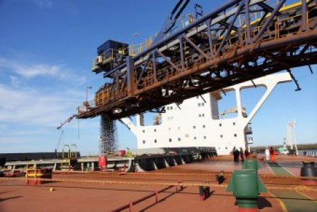 Iron ore being loaded for transport to China