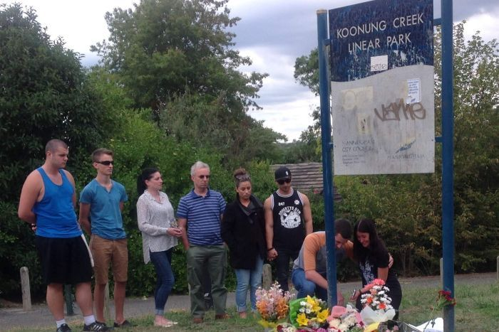 Friends leave flowers at the scene of a stabbing murder in Doncaster park